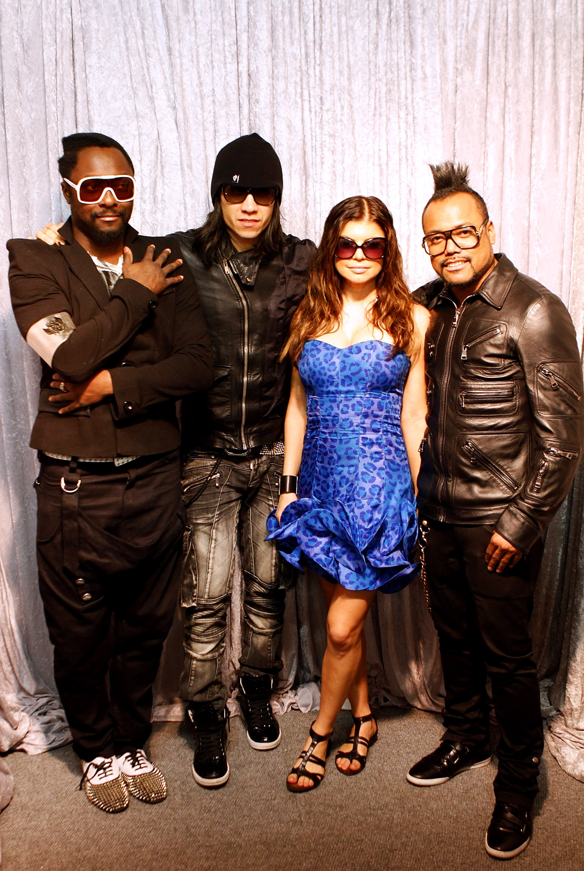 Will.i.Am-Taboo-Fergie-and-Apl.De_.Ap-of-the-Black-Eyed-Peas-pose-for-photographers-before-the-FIFA-World-Cup-Kick-off-Celebration-Concert-at-Soccer-City-in-Johannesburg-South-Africa-on-June-9-2010