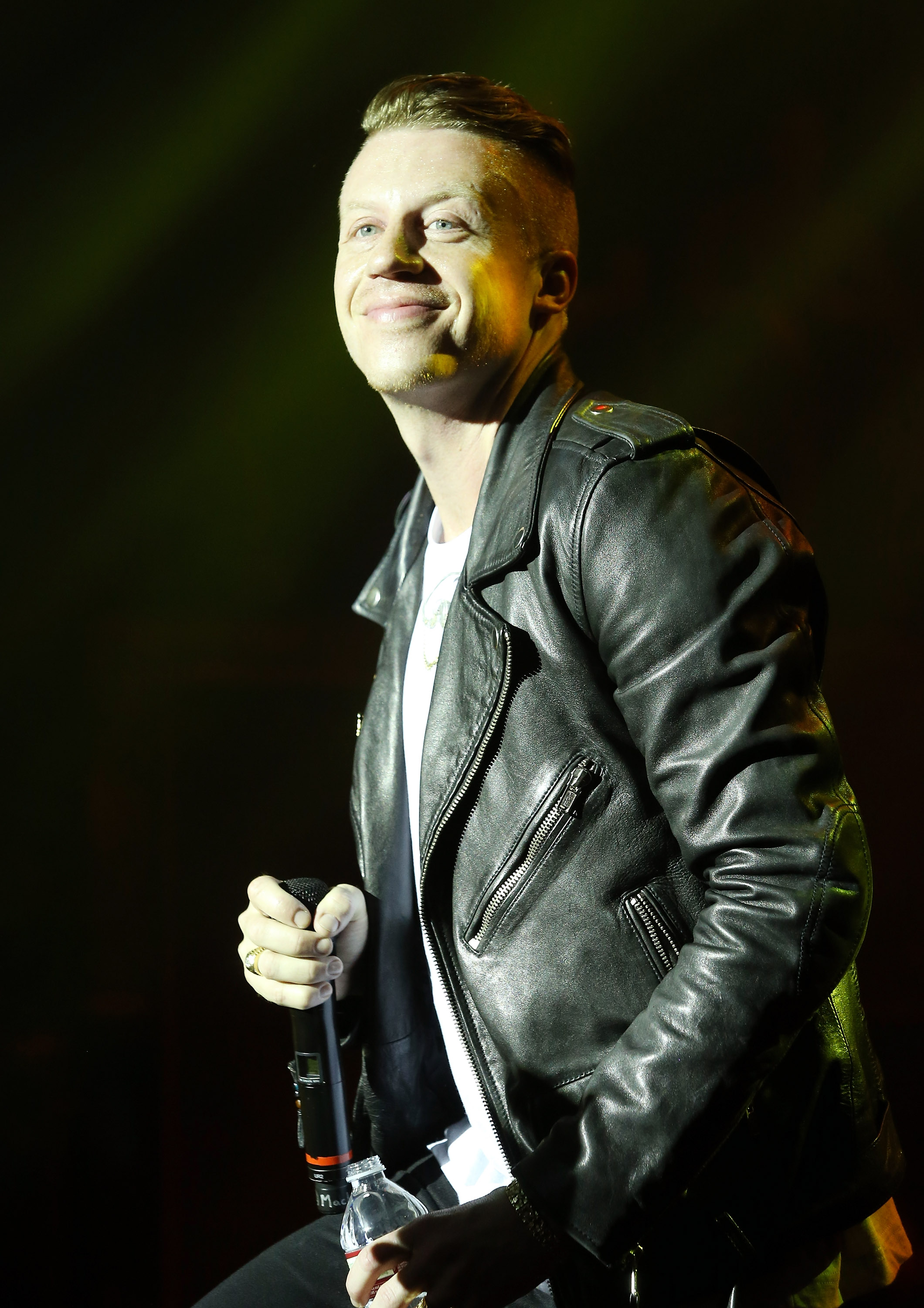 Macklemore-aka-Ben-Haggerty-performs-onstage-hosted-by-T-Mobile-held-at-Belasco-Theatre-on-January-23-2014-in-Los-Angeles