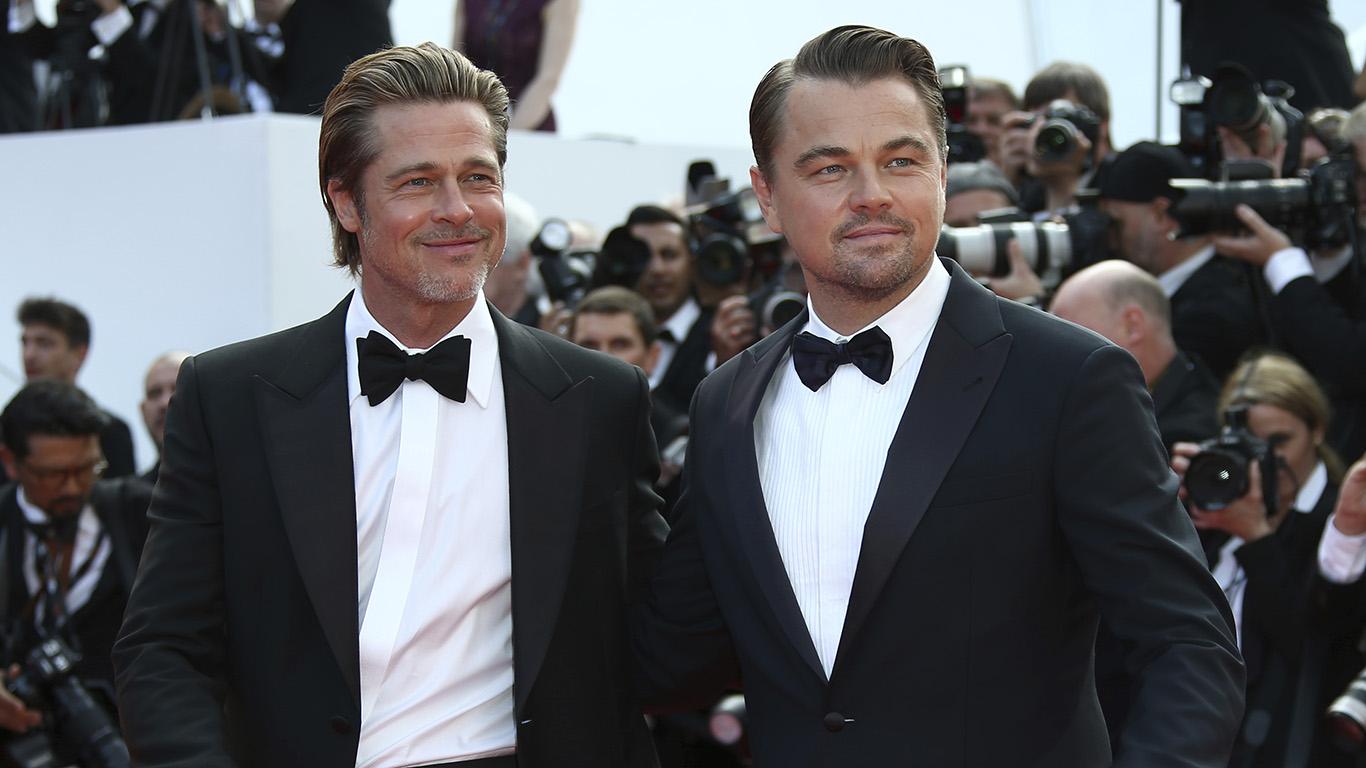 Actors Leonardo DiCaprio and Brad Pitt pose for photographers