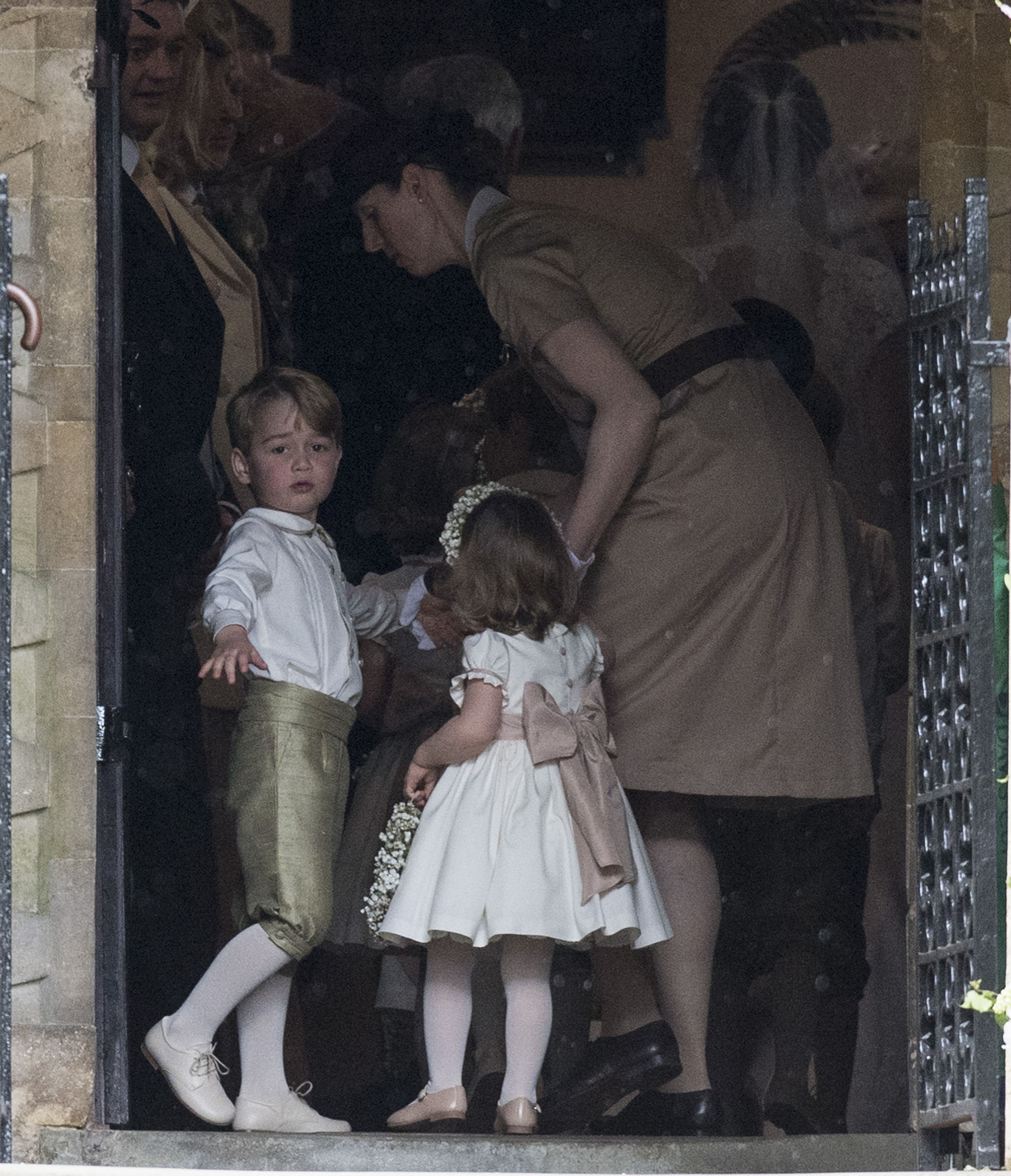 Prince George of Cambridge and Princess Charlotte of Cambridge with nanny
