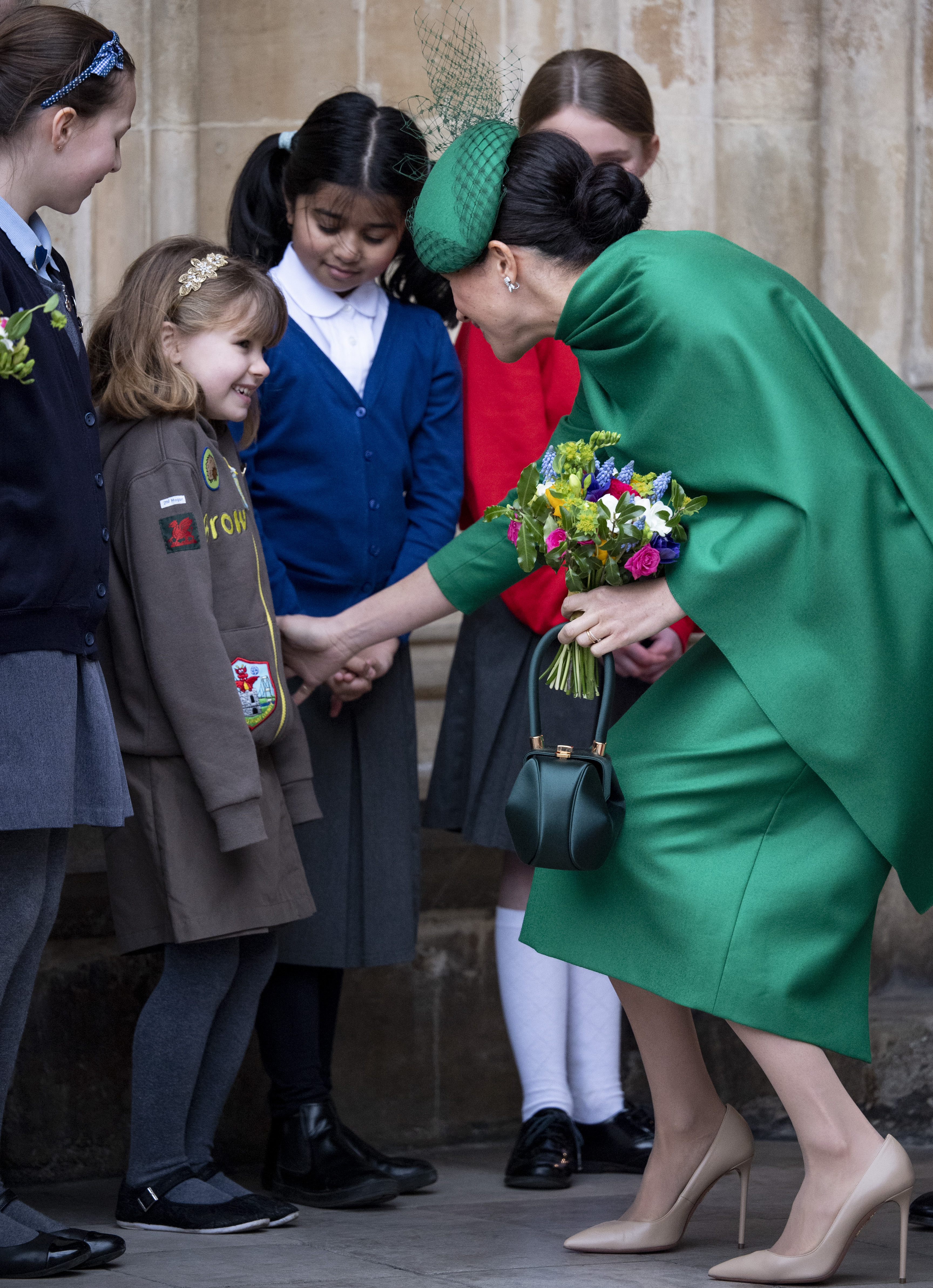 meghan markle kate middleton chat separately with same little girl amid royal reunion access 2