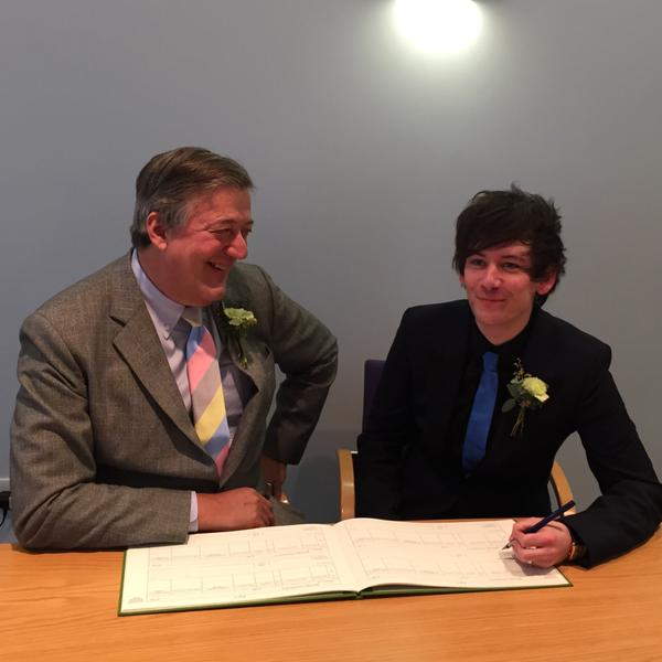 Stephen-Fry-announced-his-marriage-to-Elliott-Spencer-on-January-17-in-a-Twitter-post-that-read-'Gosh.-@ElliottGSpencer-and-I-go-into-a-room-as-two-people-sign-a-book-and-leave-as-one.-Amazing'