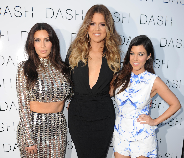 Kim-Kardashian-Khloe-Kardashian-and-Kourtney-Kardashian-attend-the-Grand-Opening-of-DASH-Miami-Beach-at-Dash-Miami-Beach-on-March-12-2014-in-Miami-Beach