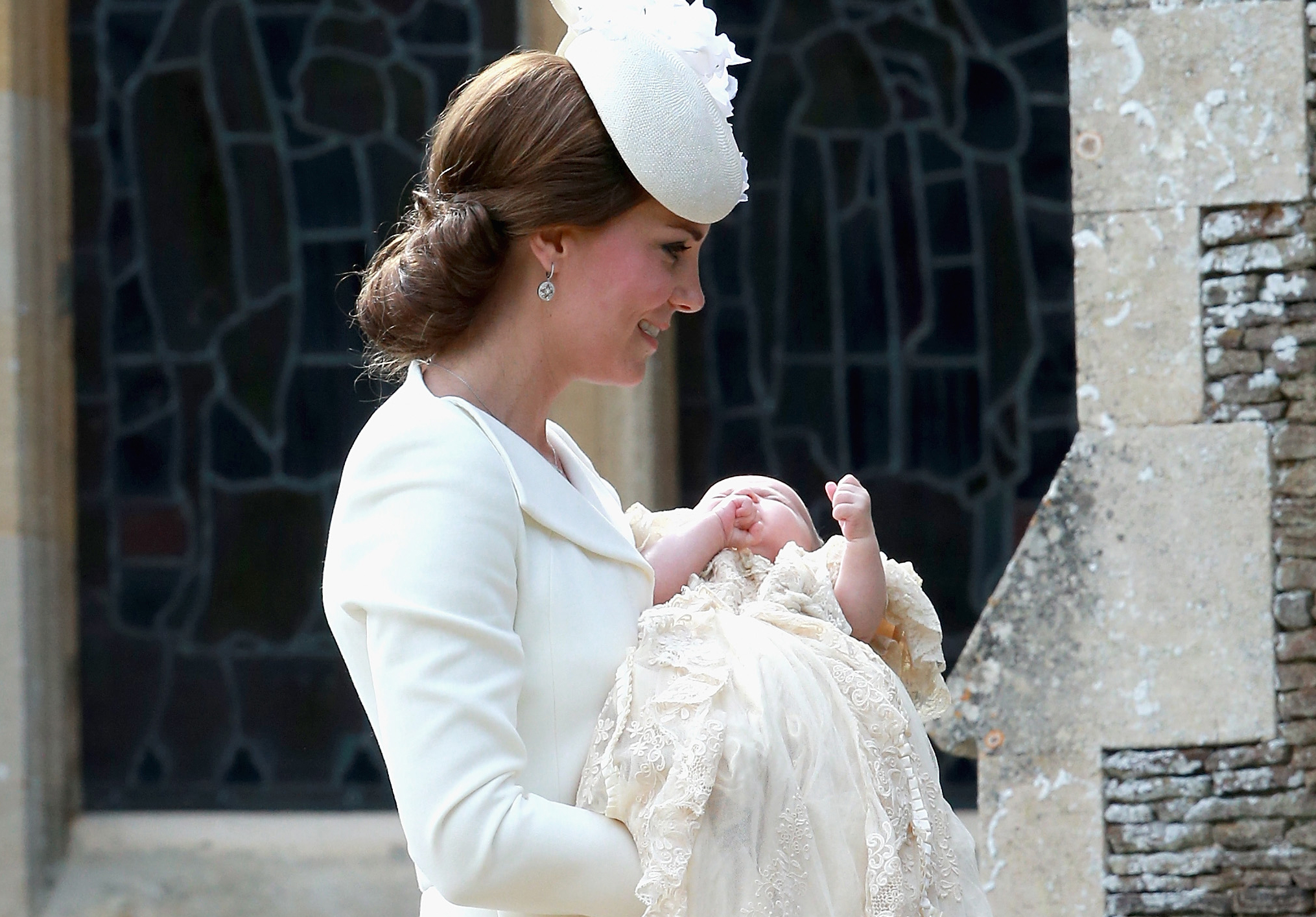 Catherine-Duchess-of-Cambridge-and-Princess-Charlotte-of-Cambridge-arrive-at-the-Church-of-St-Mary-Magdalene-on-the-Sandringham-Estate-for-the-Christening-of-Princess-Charlotte-of-Cambridge-on-July-5-2015-in-King's-Lynn-England