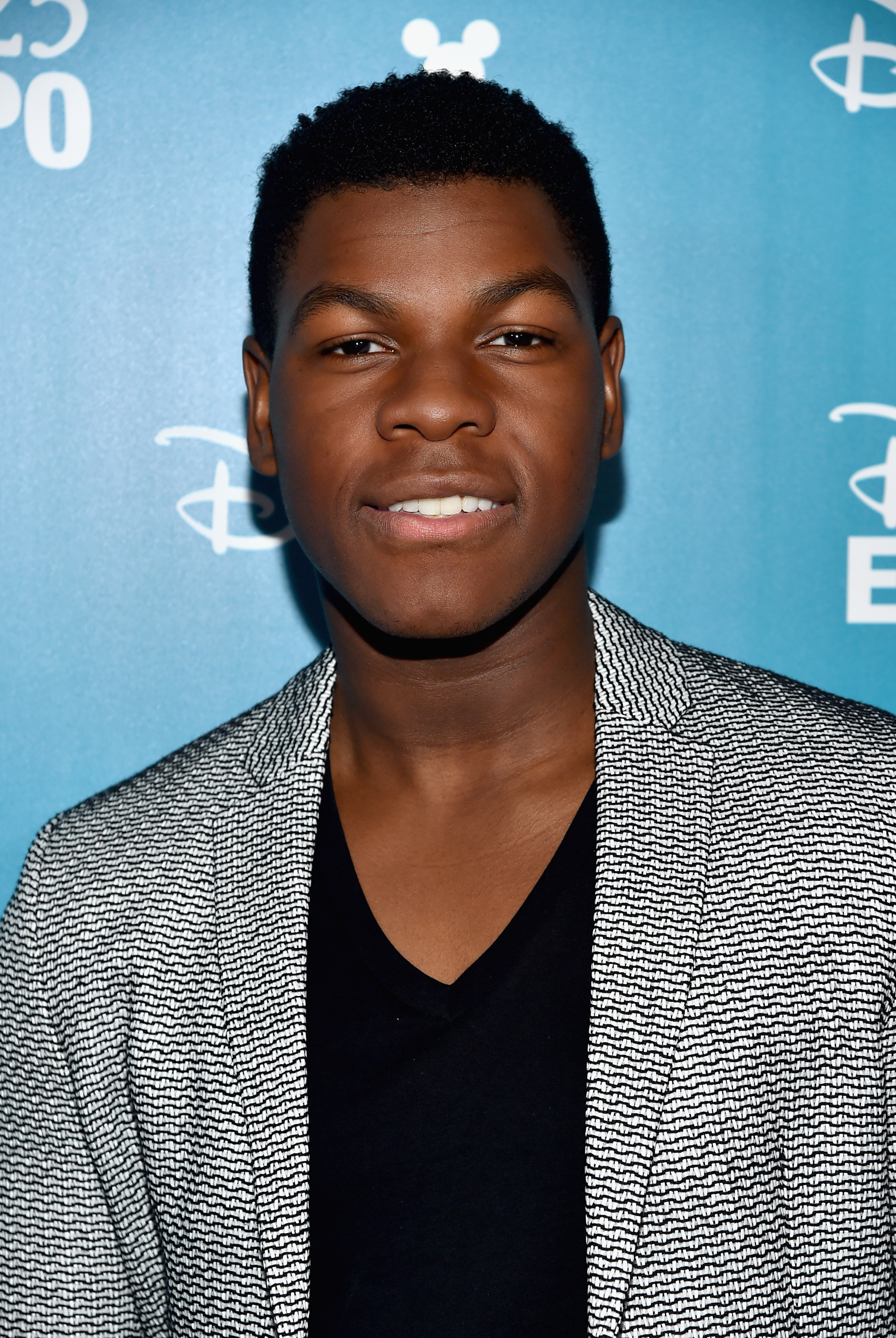 John-Boyega-of-'Star-Wars-The-Force-Awakens'-backstage-at-the-presentation-for-'Worlds-Galaxies-and-Universes-Live-Action-at-The-Walt-Disney-Studios'-presentation-at-Disney's-D23-EXPO-2015-in-Anaheim-Calif.-Aug.-15-2015