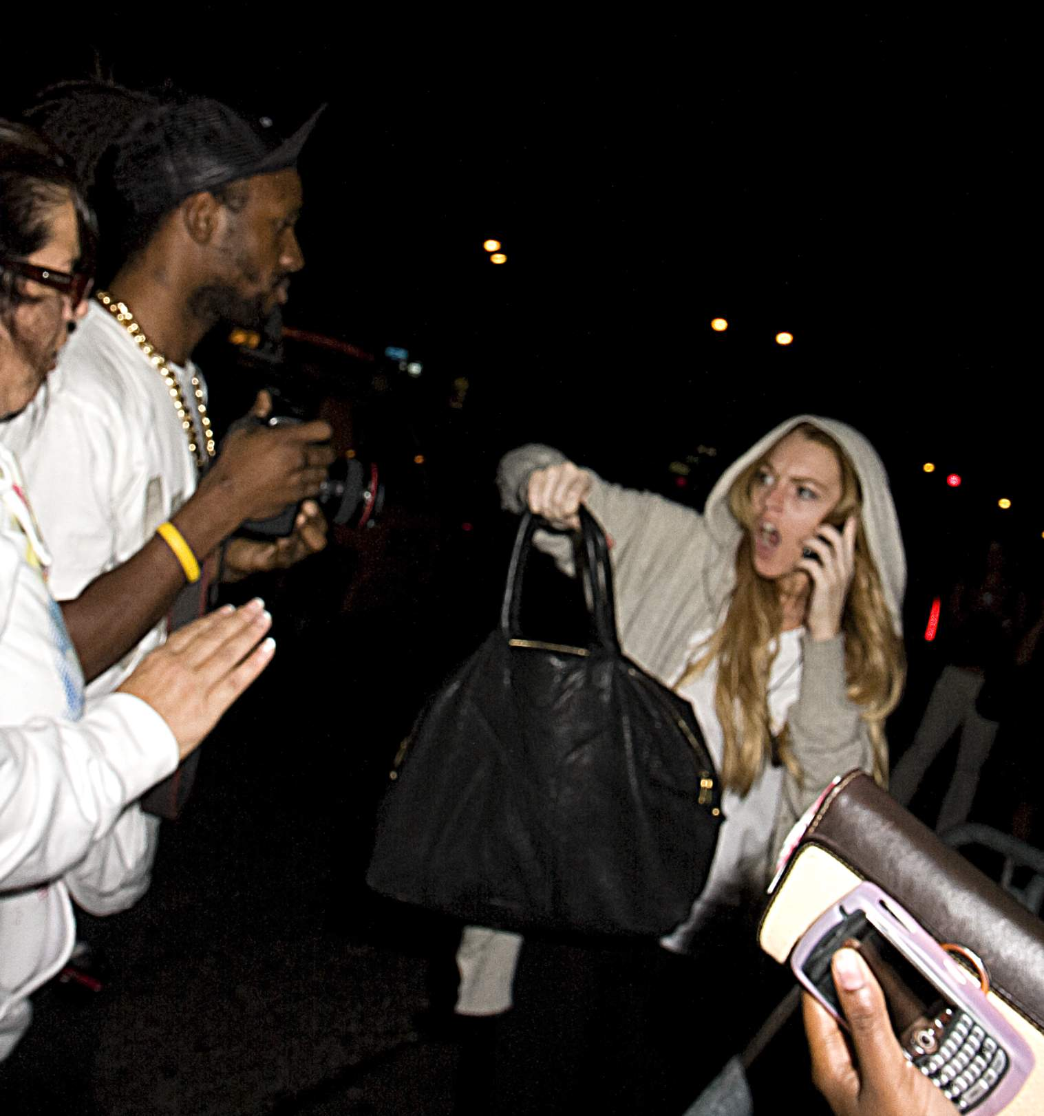 Did Lindsay Punch A Paparazzo In The Face?   Access Online