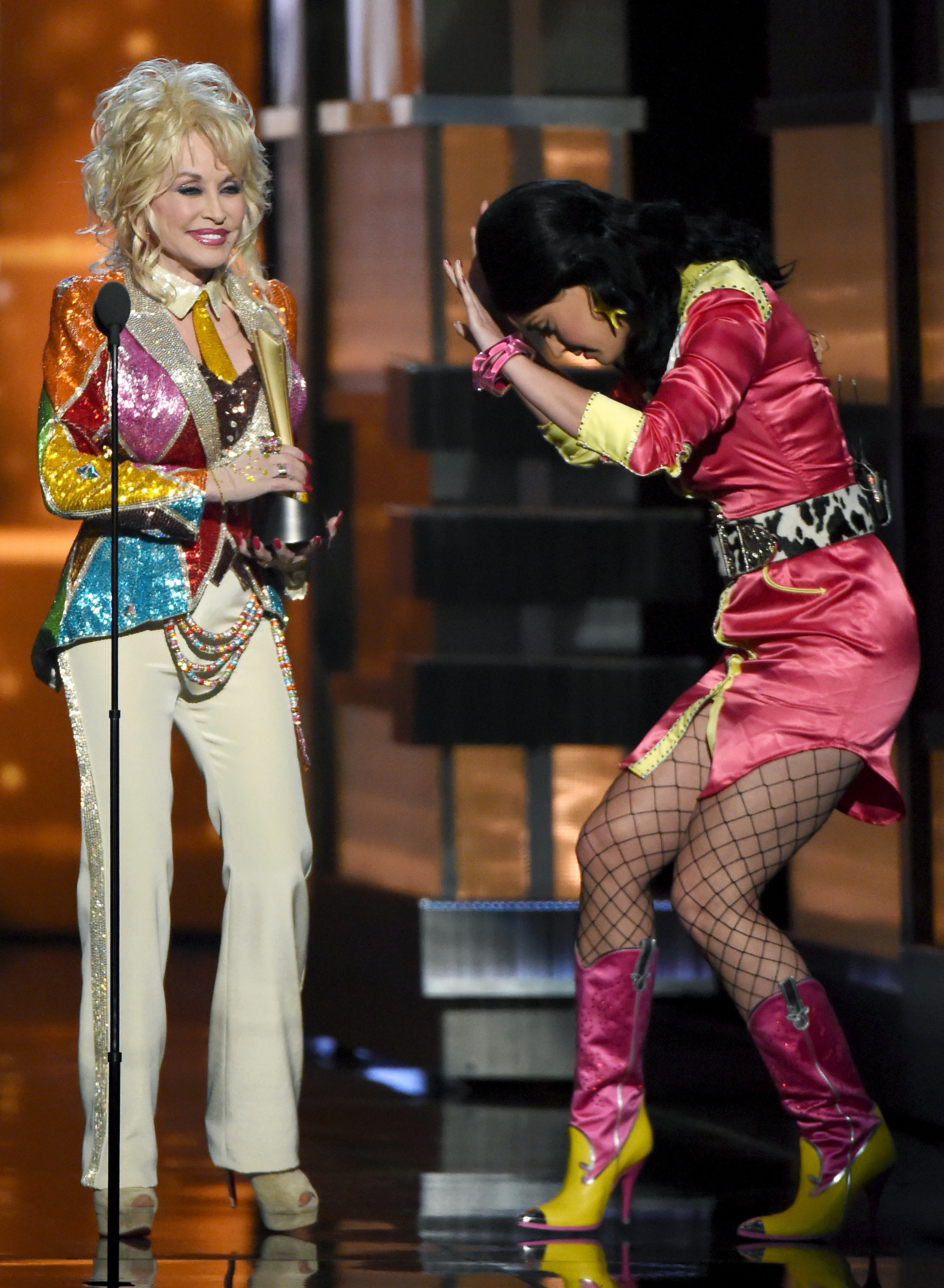 Honoree-Dolly-Parton-accepts-the-Tex-Ritter-Award-from-recording-artist-Katy-Perry-during-the-51st-Academy-of-Country-Music-Awards-at-MGM-Grand-Garden-Arena-on-April-3-2016-in-Las-Vegas