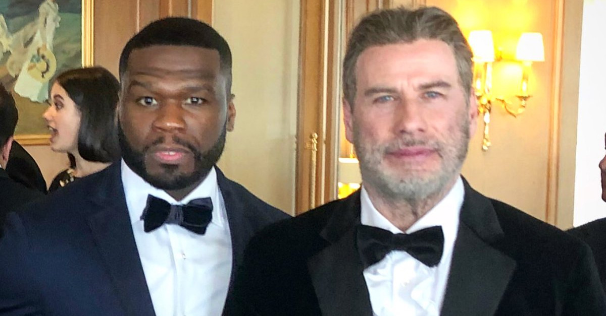 John-Travolta-Gets-Caught-Dad-Dancing-With-50-Cent-At-2018-Cannes-Film-Festival