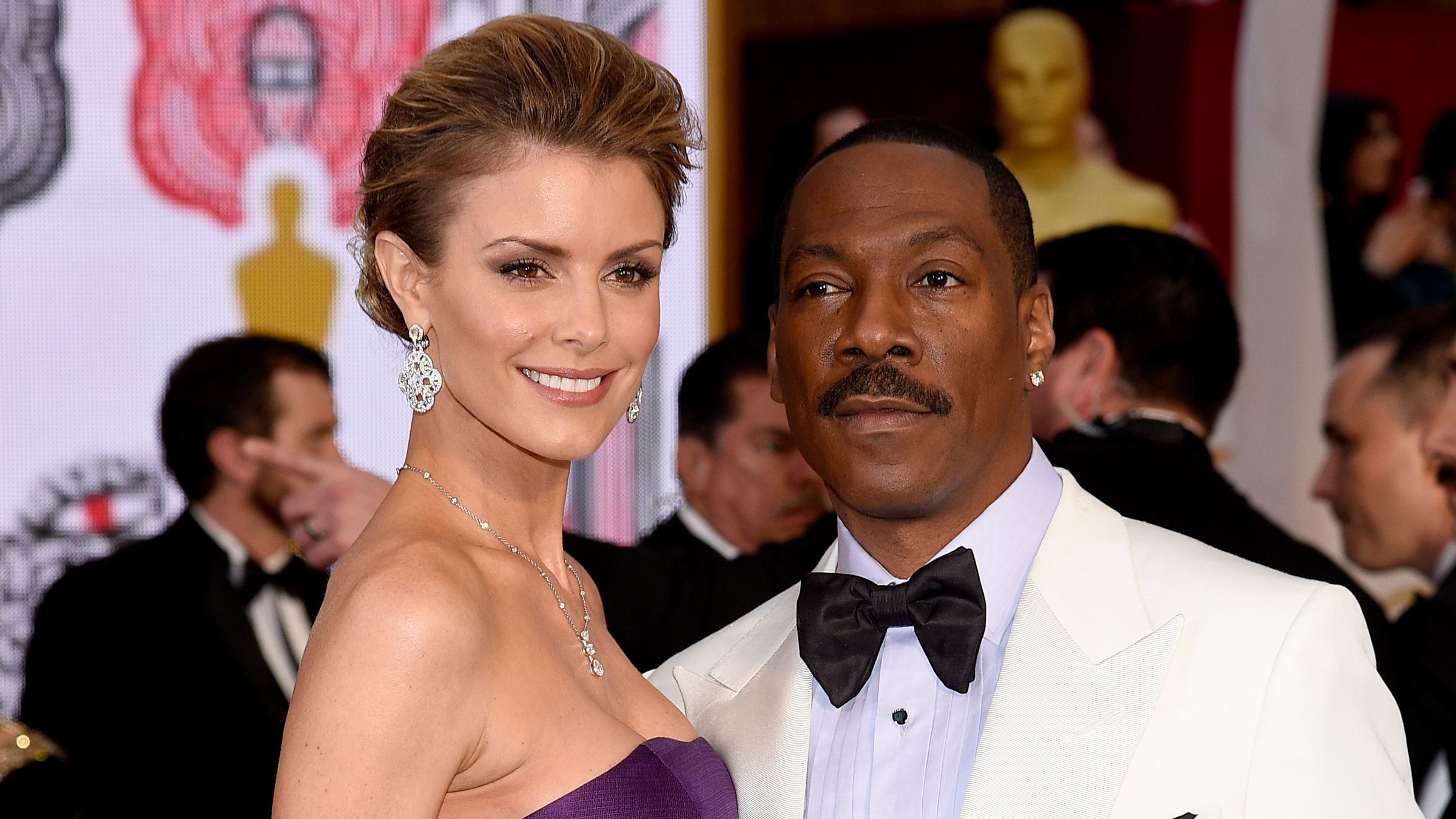 Actor Eddie Murphy (R) and model Paige Butcher attends the 87th Annual Academy Awards at Hollywood & Highland Center on February 22, 2015 in Hollywood, California. (Photo by Kevork Djansezian/Getty Images)