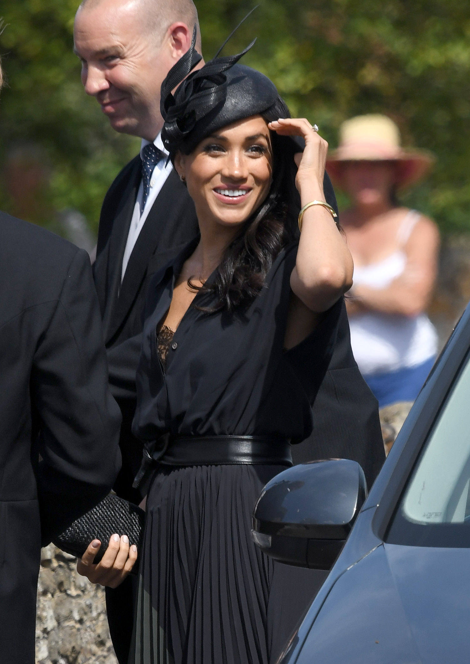 Meghan, Duchess of Sussex attends the wedding of Daisy Jenks and Charlie Van Straubenzee at Saint Mary The Virgin Church on August 4, 2018 in Frensham, United Kingdom. Prince Harry attended the same prep school as Charlie van Straubenzee and have been goo