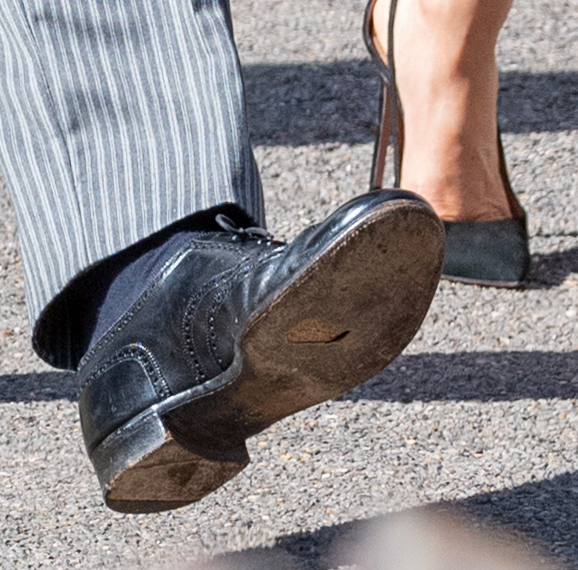 Prince Harry, Duke of Sussex, is seen with a hole in his shoe attends the wedding of Charlie Van Straubenzee and Daisy Jenks on August 4, 2018 in Frensham, United Kingdom. Prince Harry attended the same prep school as Charlie van Straubenzee and have been