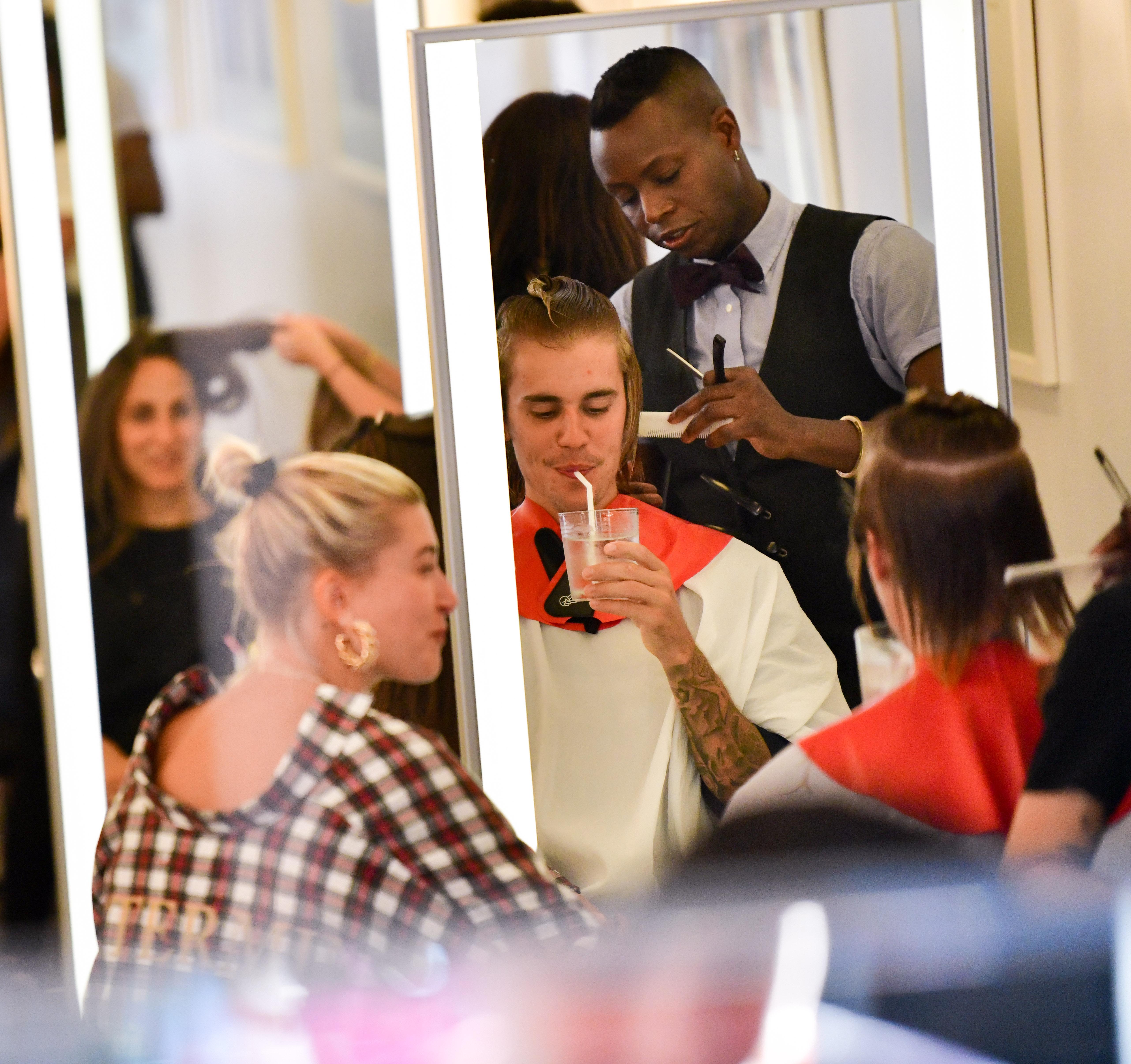 Hailey Baldwin and Justin Bieber visit Cutler hair salon in SoHo on August 8, 2018 in New York City