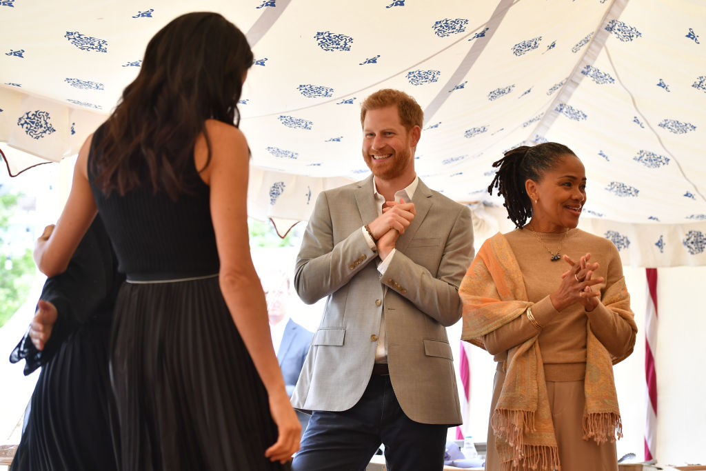 Meghan, Duchess of Sussex, Prince Harry, Duke of Sussex and Doria Ragland attend an event to mark the launch of a cookbook with recipes from a group of women affected by the Grenfell Tower fire at Kensington Palace on September 20, 2018 in London