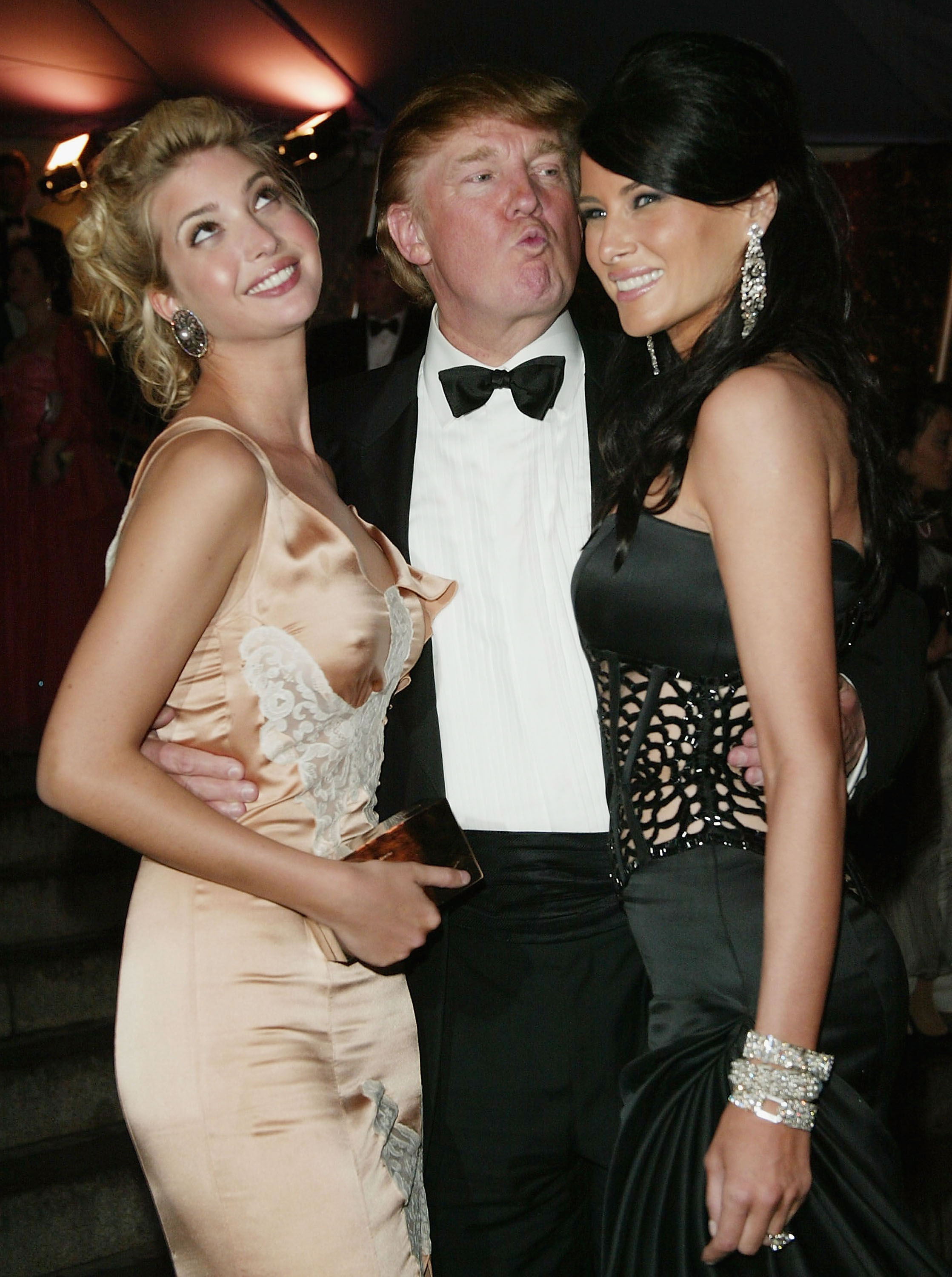 Donald Trump and his daughter Ivanka (left) and girlfriend Melania Knauss (right) attend the 'Dangerous Liaisons: Fashion and Furniture in the 18th Century' Costume Institute benefit gala on April 26, 2004 at the Metropolitan Museum of Art, in New York Ci