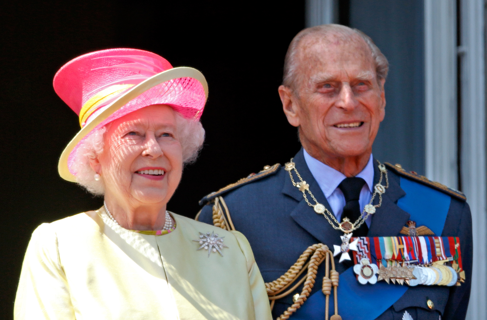 Queen Elizabeth II and Prince Philip, Duke of Edinburgh watch a flypast of Spitfire & Hurricane aircraft from the balcony of Buckingham Palace to commemorate the 75th Anniversary of The Battle of Britain on July 10, 2015 in London
