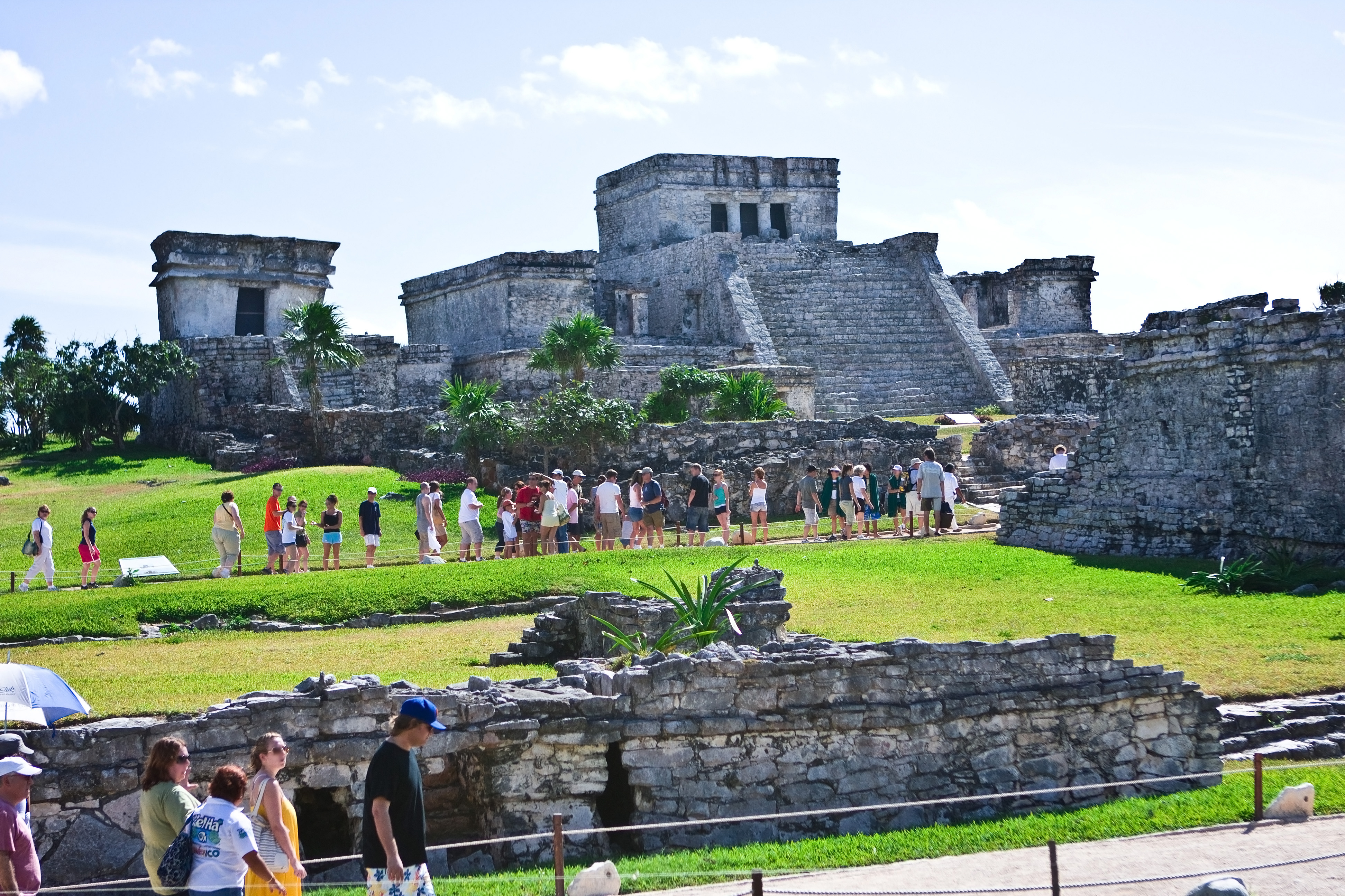 Tulum is the site of a Pre-Columbian Maya walled city serving as a major port for Cobá. The ruins are situated on 12-meter tall cliffs, along the east coast of the Yucatán Peninsula on the Caribbean Sea in the state of Quintana Roo, Mexico
