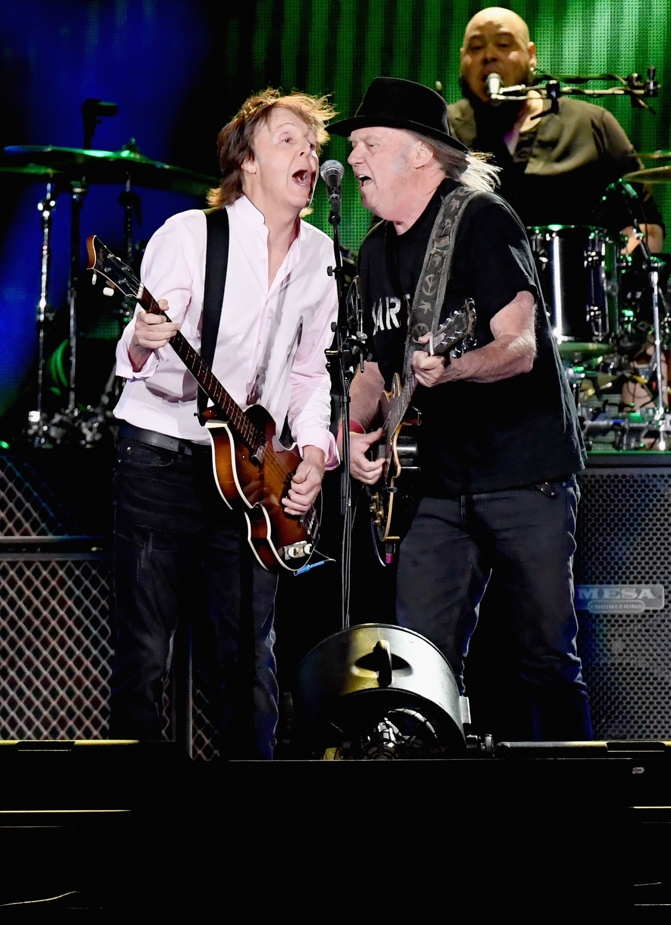 Paul McCartney and Neil Young perform onstage during Desert Trip at the Empire Polo Field on October 8, 2016 in Indio