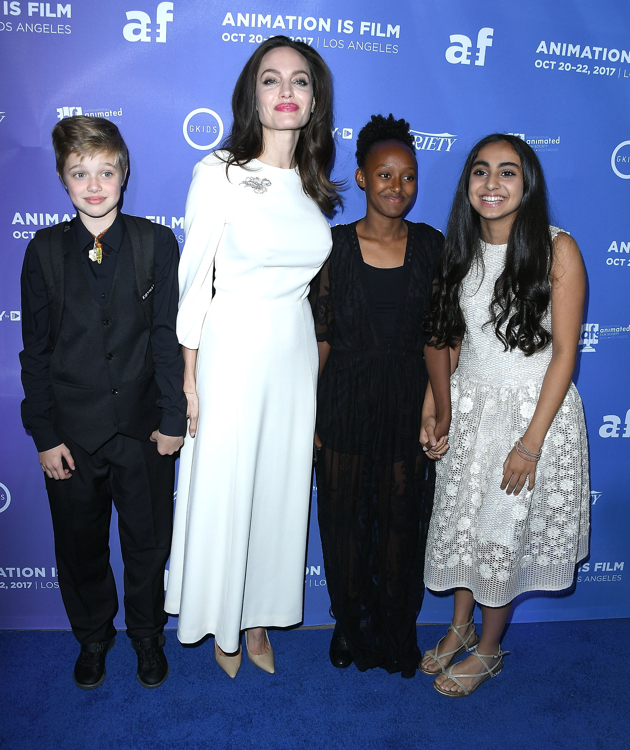 Shiloh Jolie-Pitt, Angelina Jolie, Zahara Jolie-Pitt and Saara Chaudry arrive at the Premiere Of Gkids' 'The Breadwinner' at TCL Chinese 6 Theatre on October 20, 2017 in Hollywood