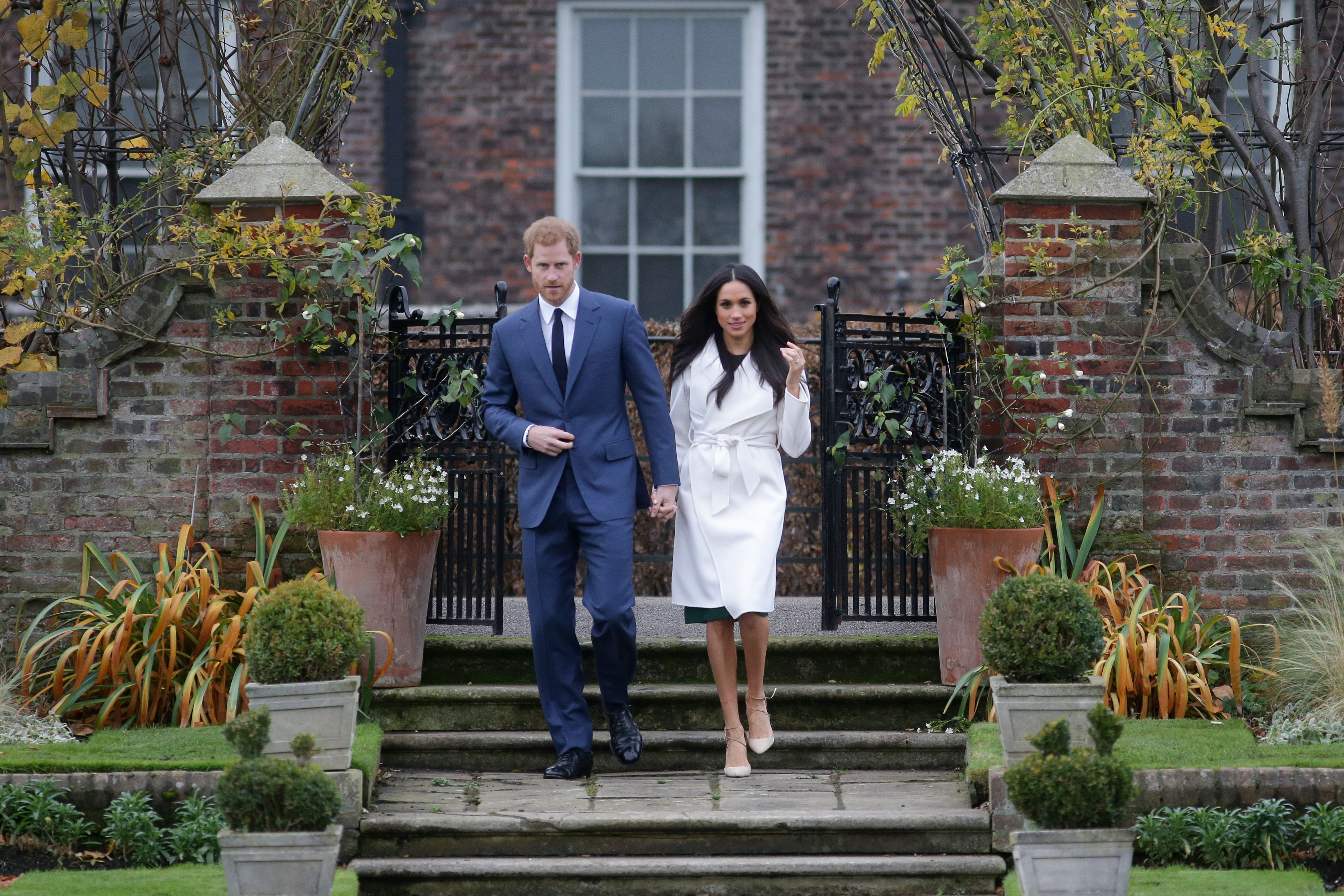 Prince Harry and his fiancée Meghan Markle pose for a photograph in the Sunken Garden at Kensington Palace in west London on November 27, 2017