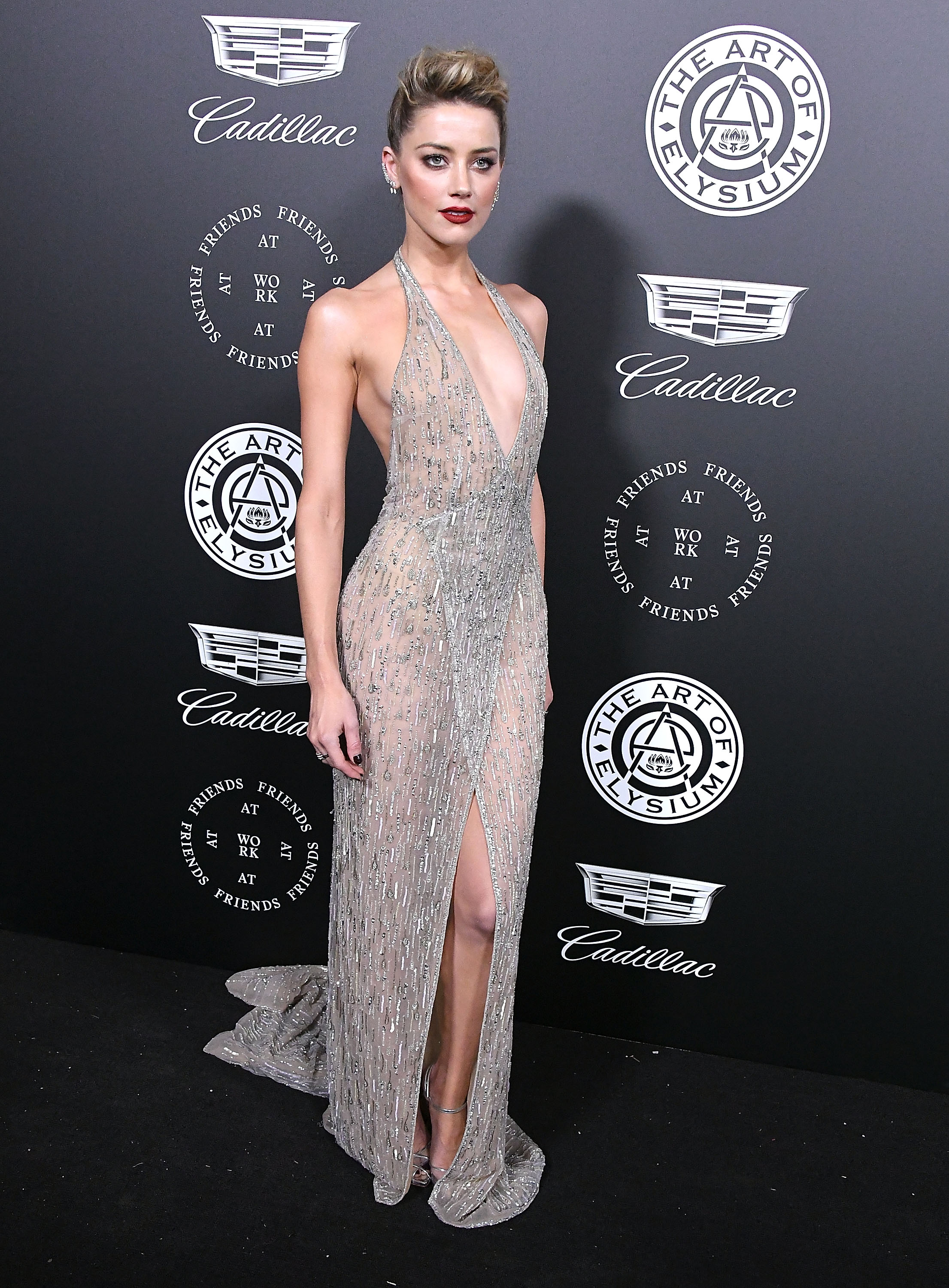 Amber-Heard-Dazzles-In-Sparking-Silver-Backless-Gown-At-Art-Of-Elysium-Gala