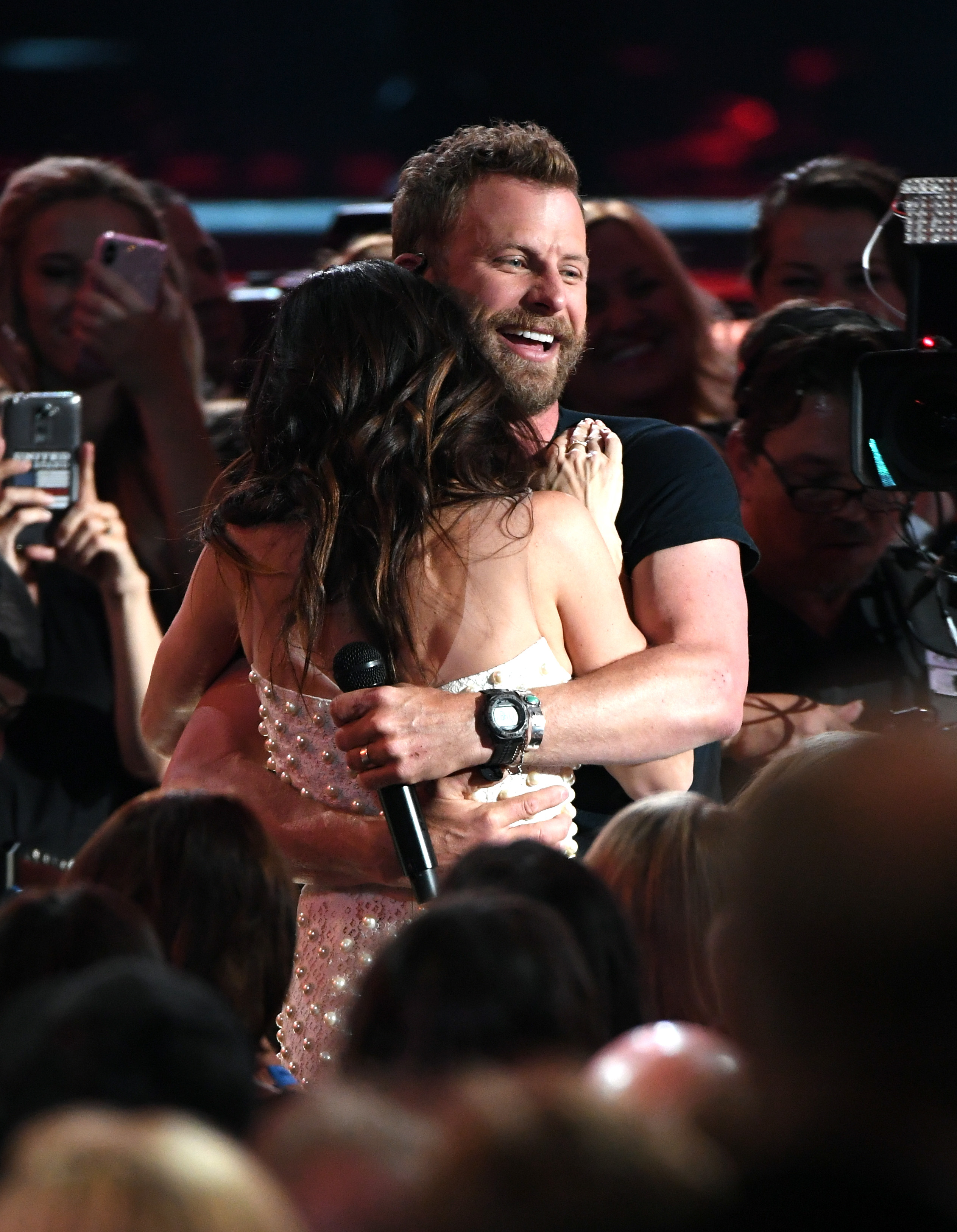 Dierks Bentley embraces his wife Cassidy Black following his performance at the 2018 ACM Awards. (Credit: Getty Images)