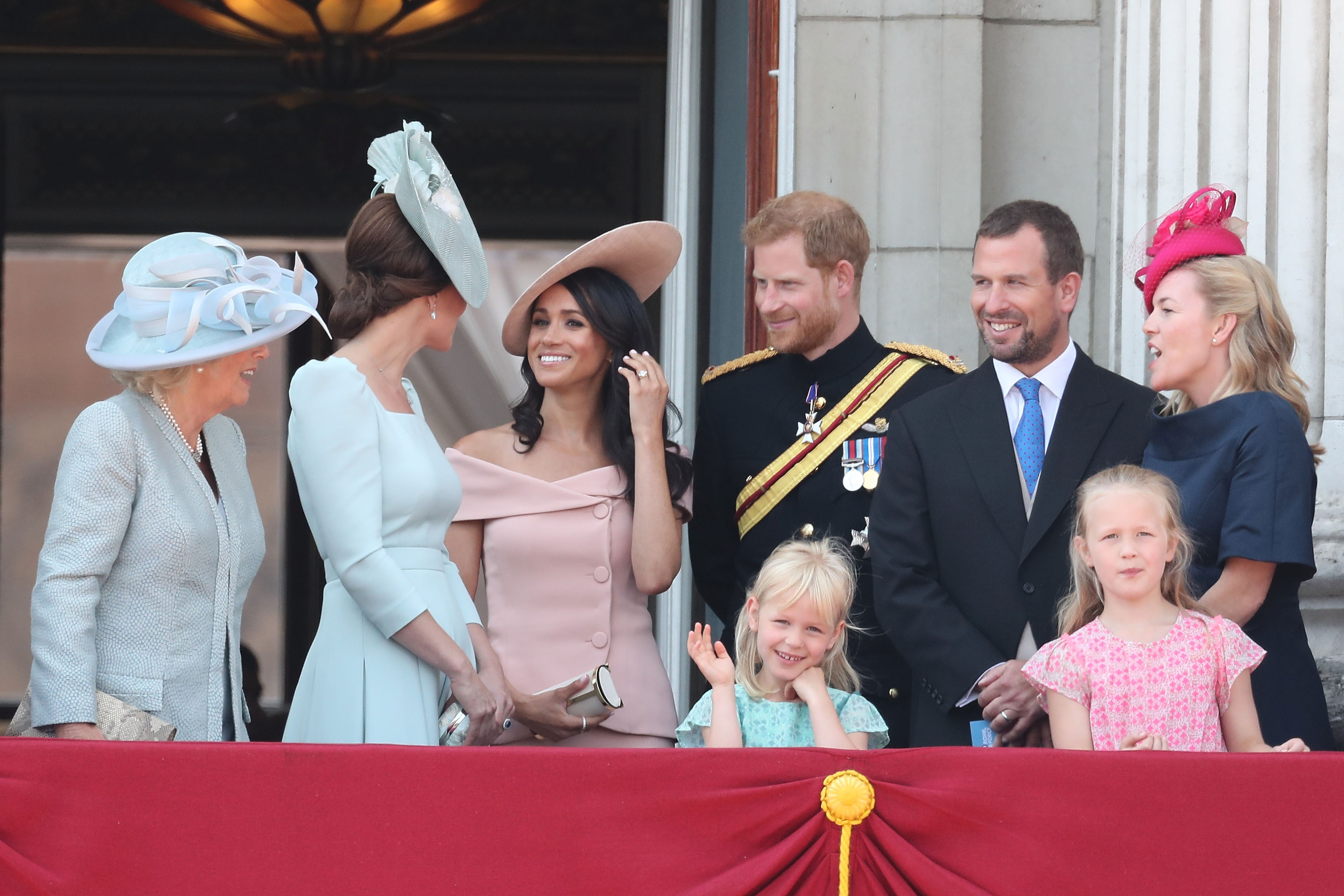 Camilla, Duchess Of Cornwall, Catherine, Duchess of Cambridge, Meghan, Duchess of Sussex, Prince Harry, Duke of Sussex, Peter Phillips, Autumn Phillips, Isla Phillips and Savannah Phillips on the balcony of Buckingham Palace during Trooping The Colour on