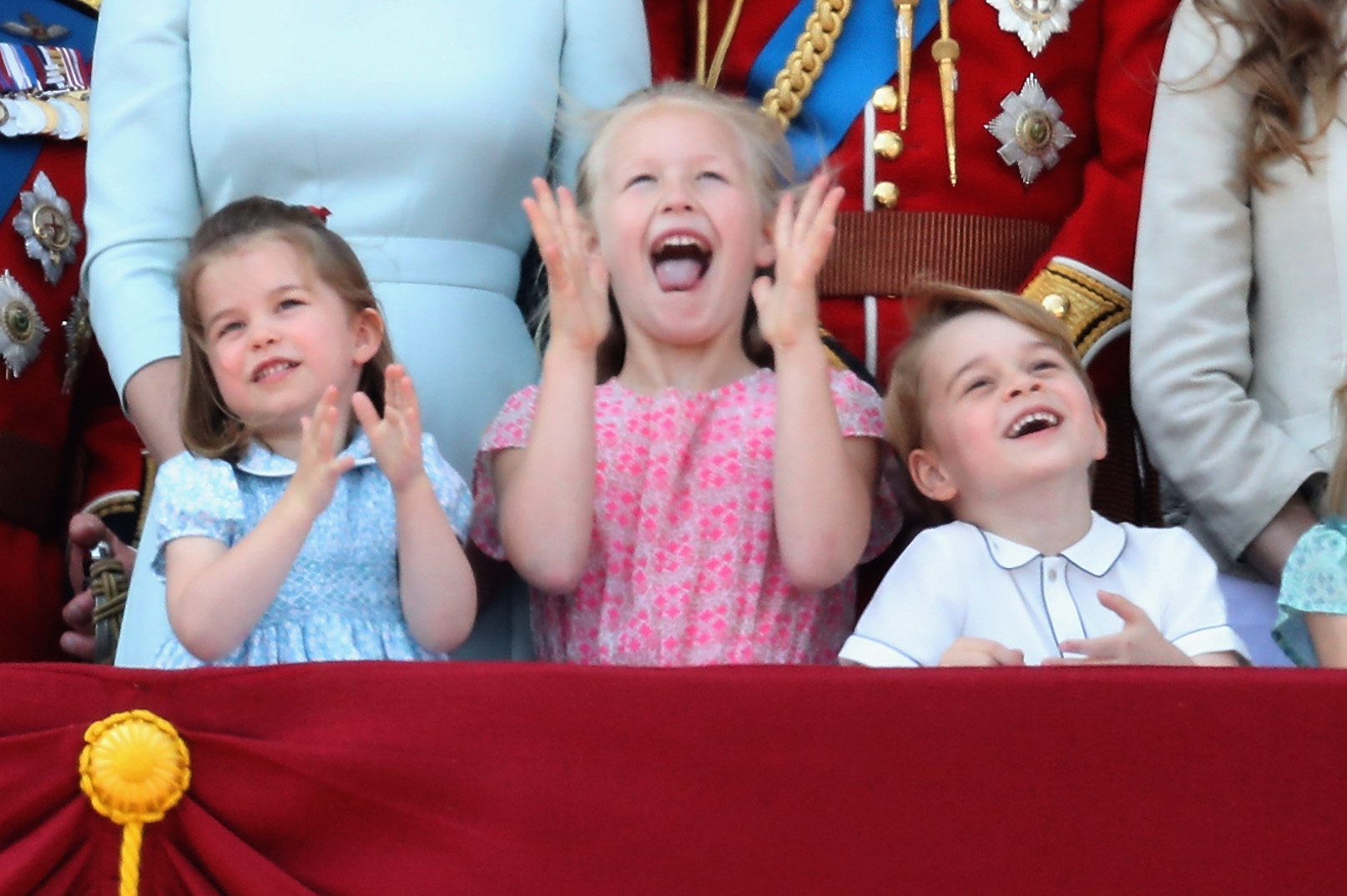 Princess Charlotte of Cambridge, Savannah Phillips, Prince George of Cambridge watch the flypast on the balcony of Buckingham Palace during Trooping The Colour on June 9, 2018 in London