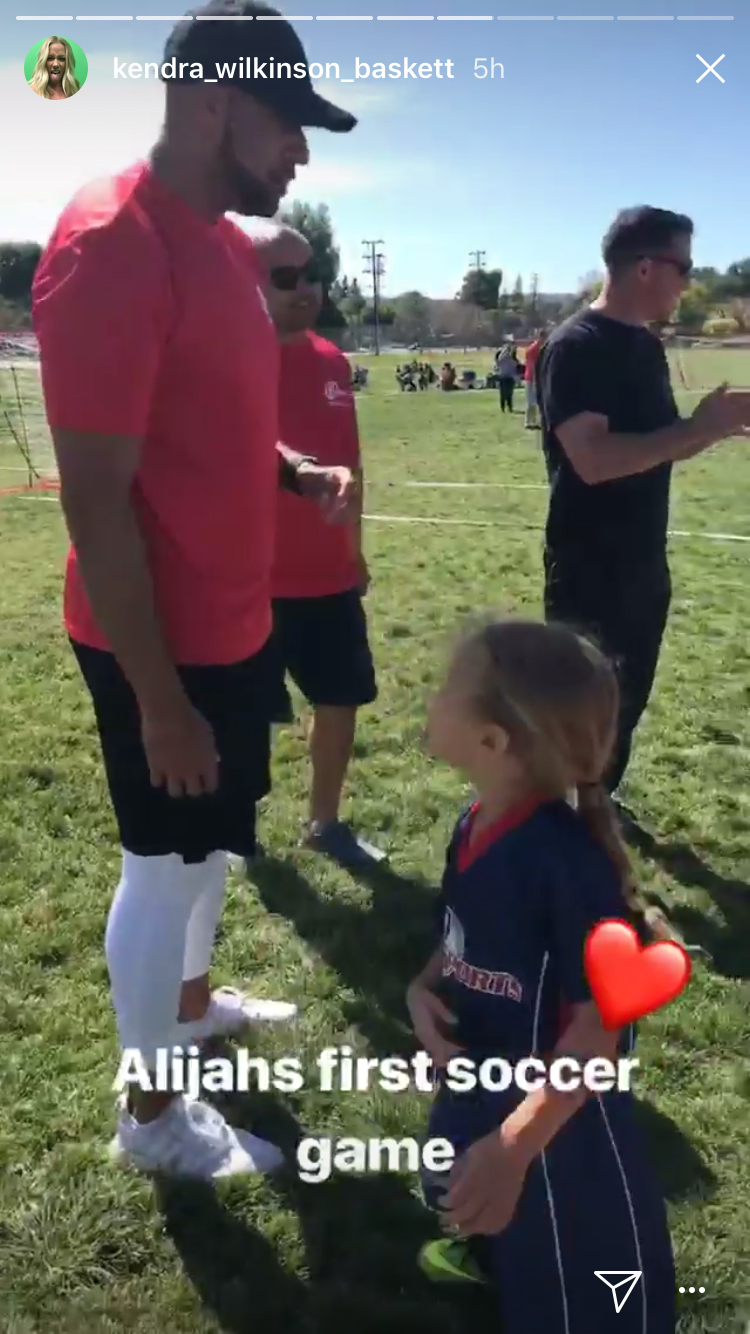 Kendra Wilkinson captures former husband Hank Baskett and 3-year-old daughter Alijah at Alijah's first soccer game on April 8, 2018