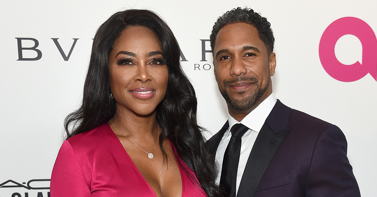 Kenya Moore and Marc Daly attend the 26th annual Elton John AIDS Foundation's Academy Awards Viewing Party at The City of West Hollywood Park on March 4, 2018 in West Hollywood