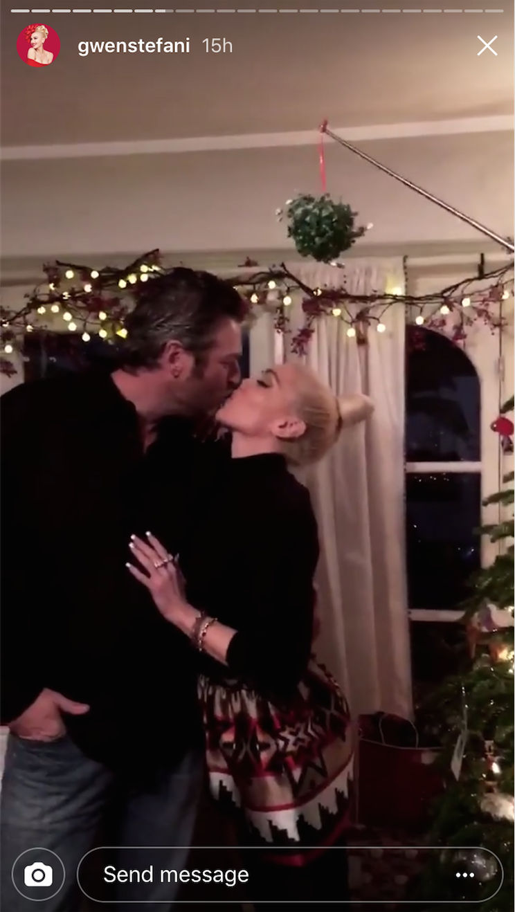 Gwen Stefani and Blake Shelton share a kiss on Christmas Eve 2017.