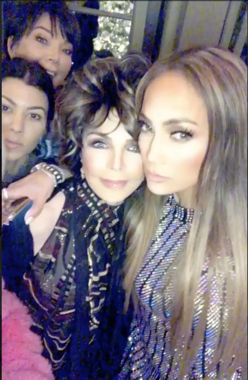 Jennifer Lopez and Joan Collins cuddle up during Taco Wednesday on Kim Kardashian's Instagram Story