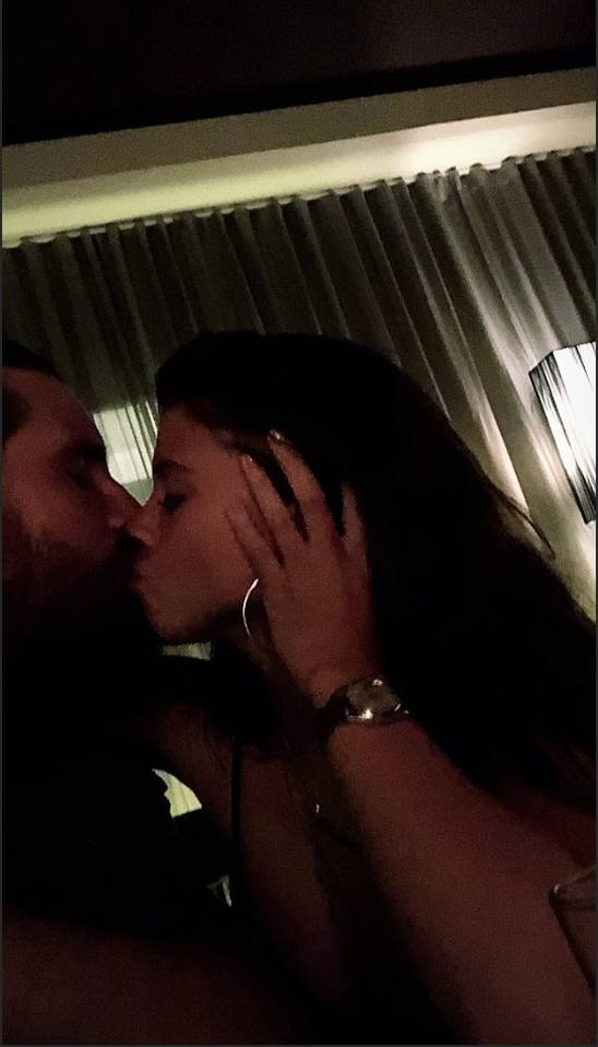 Sofia Richie and Scott Disick share a kiss on his 35th birthday. (Credit: Instagram Story)