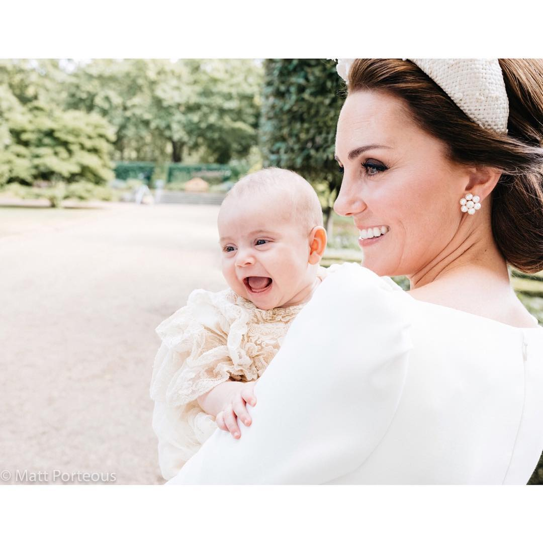 Prince-Louis-Has-A-Big-Beaming-Smile-As-Hes-Carried-By-Mom-Kate-Middleton-In-New-Official-Christening-Portrait