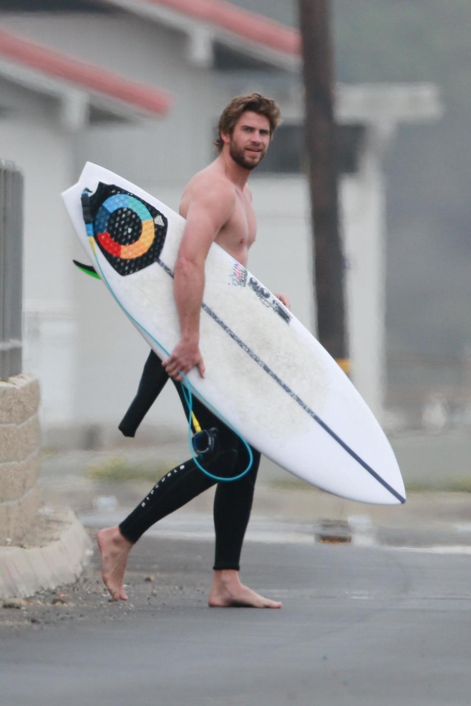 6 Insanely Hot Pics Of Liam Hemsworth Surfing In Malibu