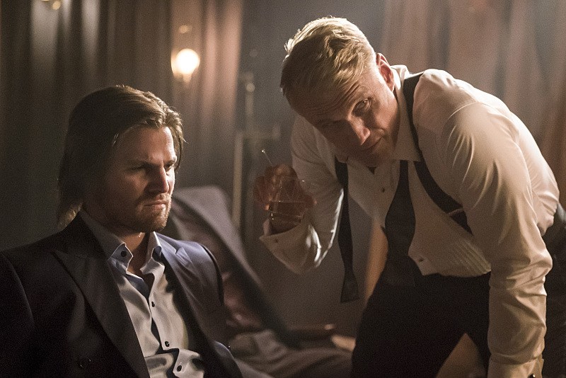 Stephen Amell as Oliver Queen and Dolph Lundgren as Konstantin Kovar in 'Arrow' Season 5, Episode 6 — 'So It Begins'