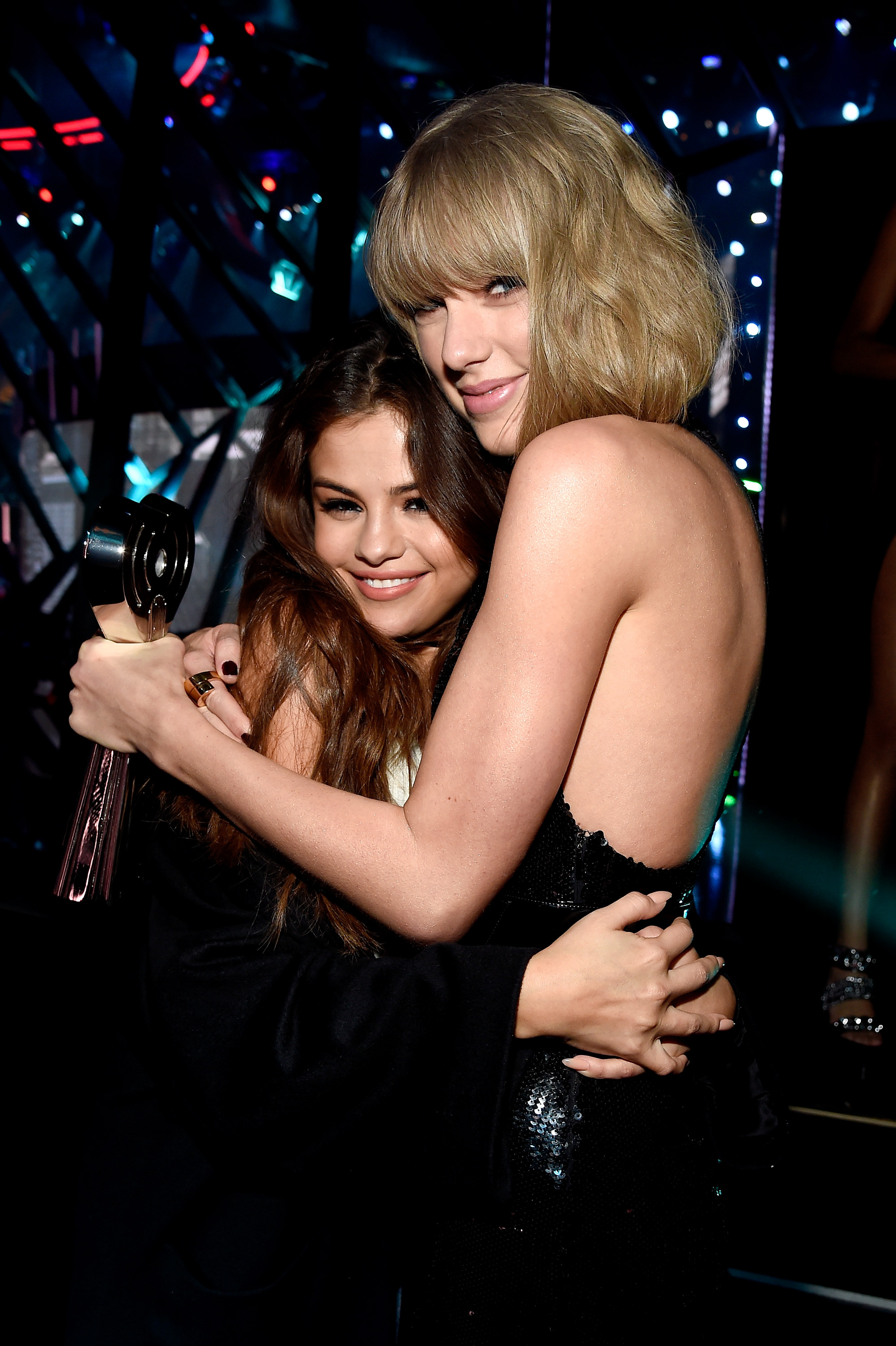 Taylor Swift, winner of the Album of the Year award for '1989,' embraces Selena Gomez backstage at the iHeartRadio Music Awards which broadcasted live on TBS, TNT, AND TRUTV from The Forum on April 3, 2016 in Inglewood