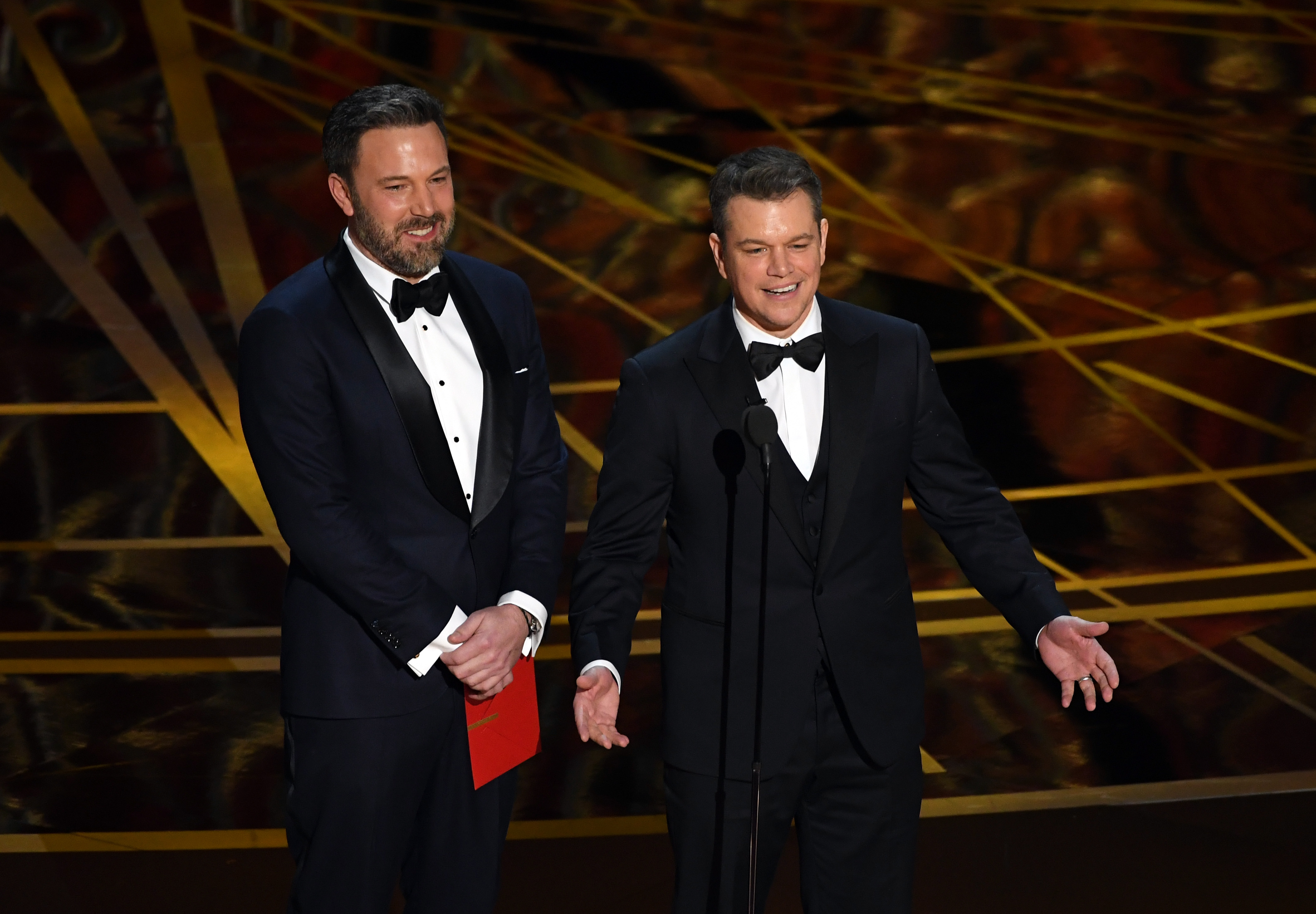 Ben Affleck and Matt Damon speak onstage during the 89th Annual Academy Awards at Hollywood & Highland Center on February 26, 2017 in Hollywood