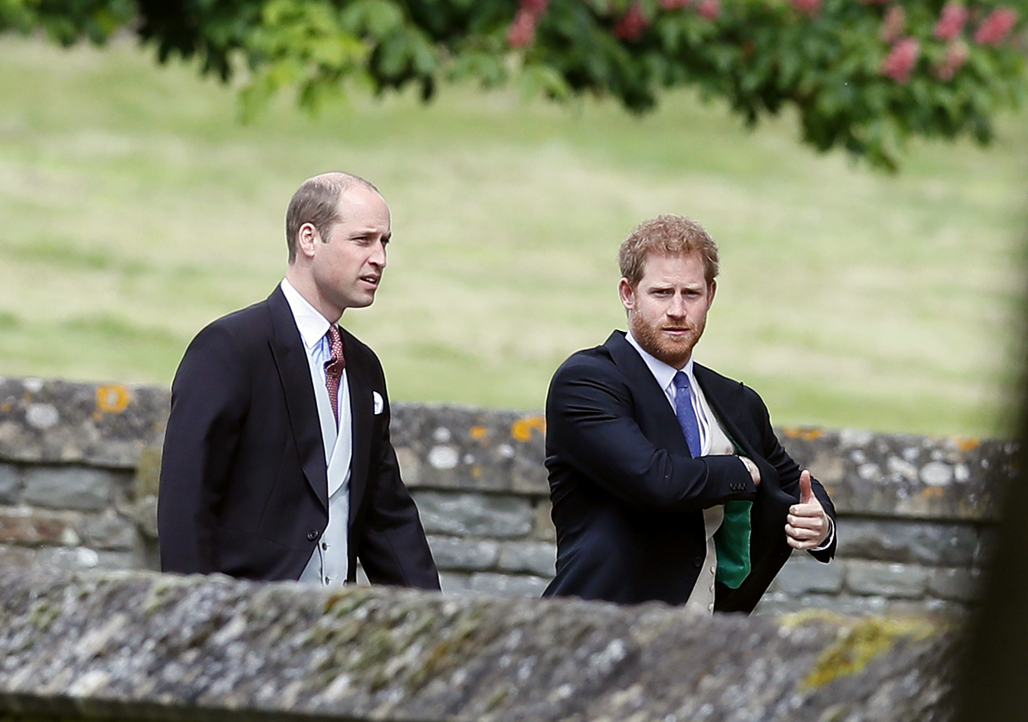 Britain's Prince William and his brother Prince Harry arrive for the wedding of Pippa Middleton