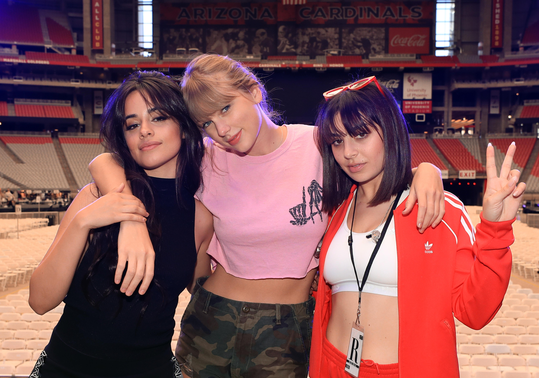 Camila Cabello, Taylor Swift, and Charli XCX pose onstage before opening night of Taylor Swift's 2018 Reputation Stadium Tour at University of Phoenix Stadium on May 8, 2018 in Glendale, Ariz.