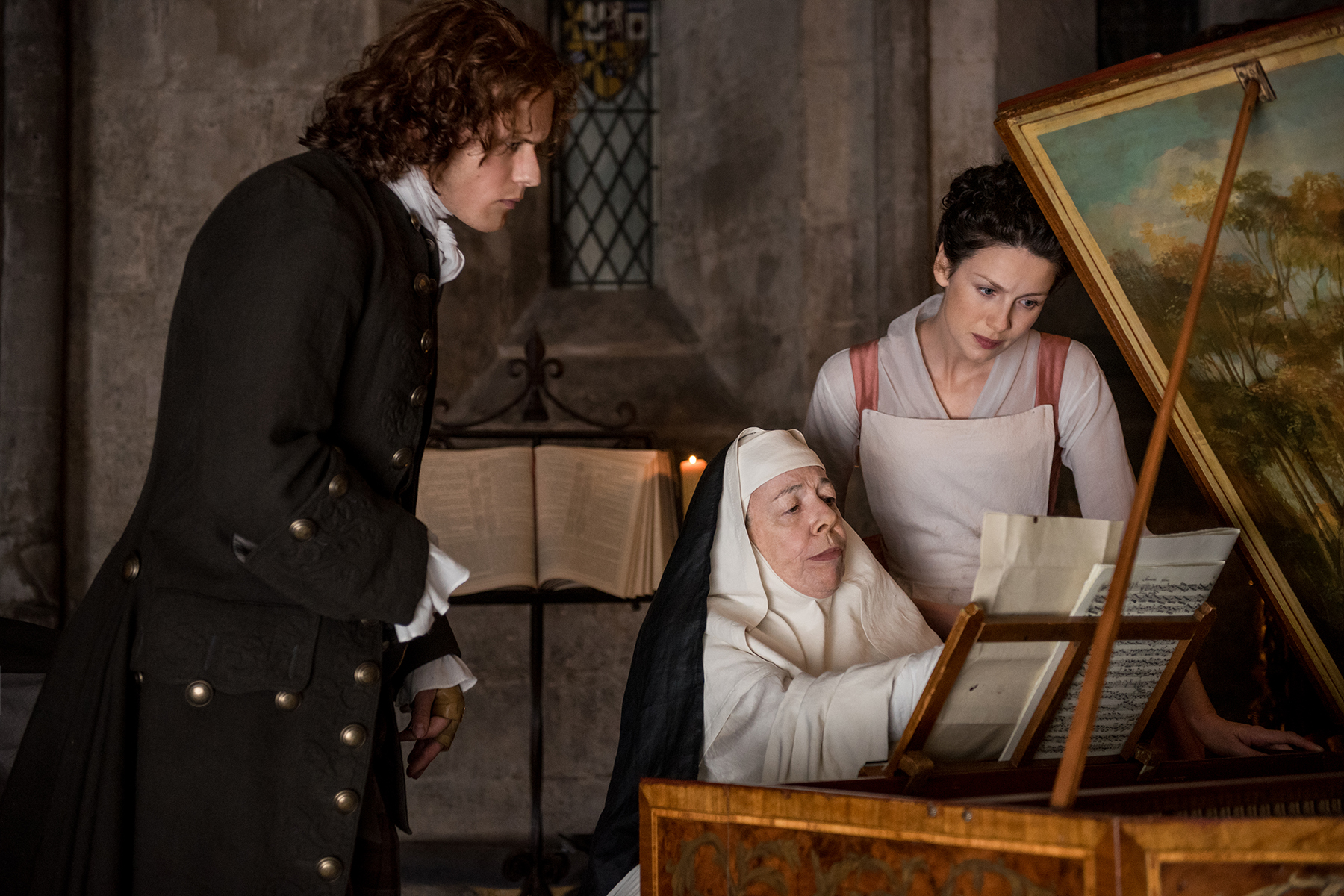 Sam Heughan as Jamie Fraser, Frances de la Tour as Mother Hildegarde and Caitriona Balfe as Claire Fraser in 'Outlander' Season 2, Episode 3 — 'Useful Occupations and Deceptions'